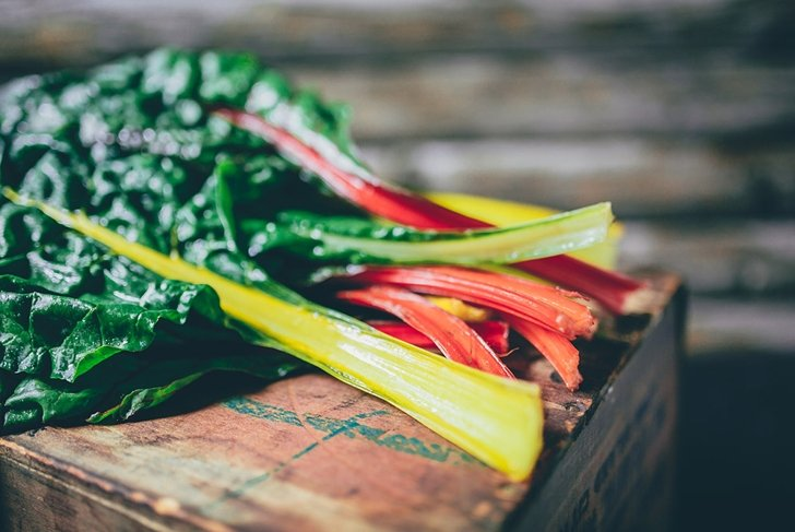 Swiss chard on a rustic background