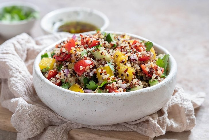Fresh quinoa tabbouleh salad with tomatoes, peppers and cucumbers