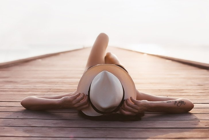 tanning woman on beach