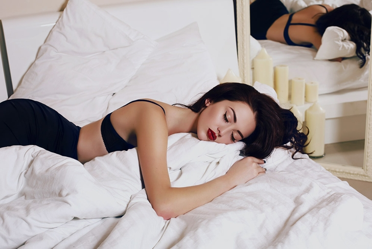 sleeping woman in bed with makeup on