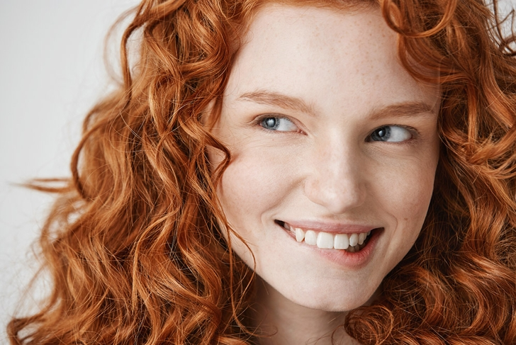 redhead girl biting lips