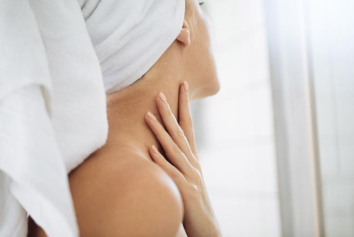 woman touching neck skincare