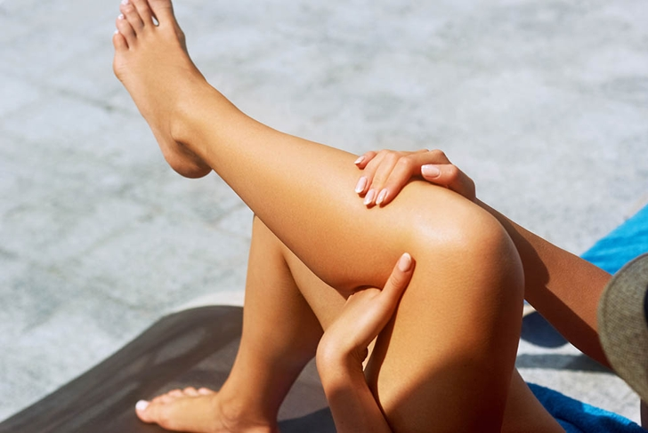 woman tanning legs
