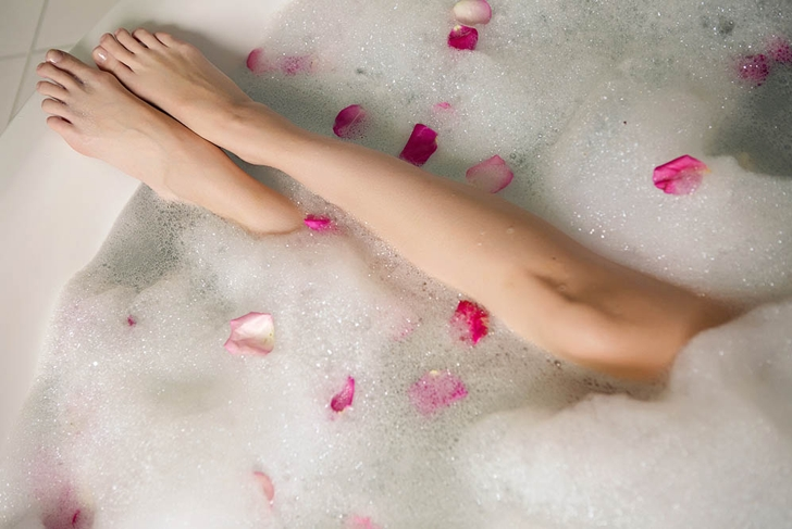 pink rose petals in a round tub with legs girls