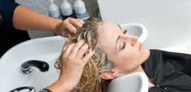 Hairdressers screening for cancer while snipping