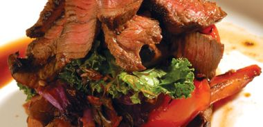 Grilled Bison Flat Iron Steak with Wilted Wintergreens and Marinated Chili Mushrooms and Peppers