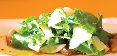 Sliced Prosciutto with Preserved Lemon, Shaved Pear, and Arugula