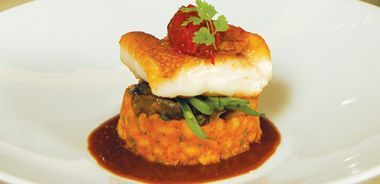 Pan-seared Snapper on a Bean Cassoulet with Mushroom Ragout and Pepper Relish in a Grainy Mustard Sauce