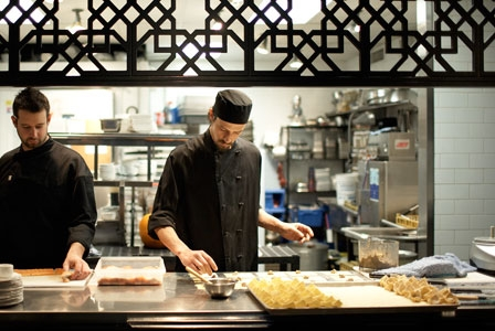 Chefs putting some sweet sanafir into a dish