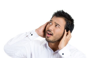 Asian-man-covering-ears_169647590