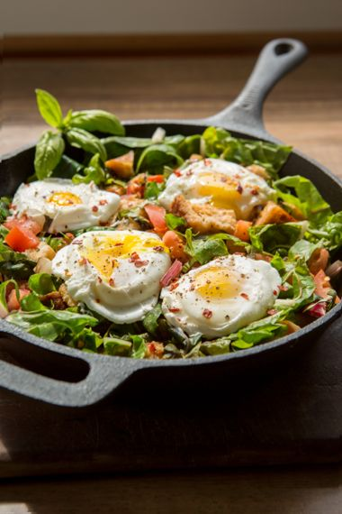 Warm Swiss Chard and Tomato Skillet Salad with Poached Eggs and Croutons