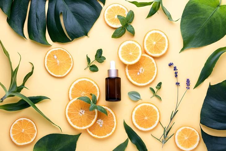Natural cosmetics concept, fresh ingredients for skin treatment vitamin C serum, flat lay