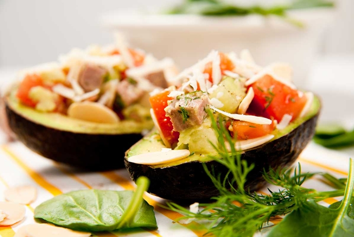 Small Appetizer Sized Paleo Salads Served in Halved Avocados