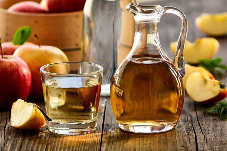 Apple cider vinegar still life