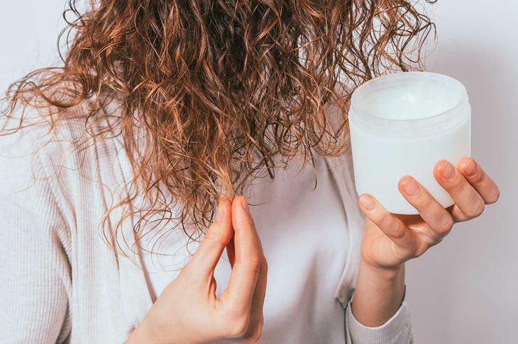 Female's hands apply cosmetic coconut oil