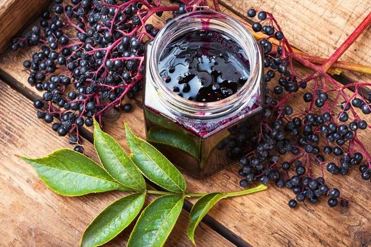 Elderberry jam and fresh berries.Homemade jam.Seasonal berries