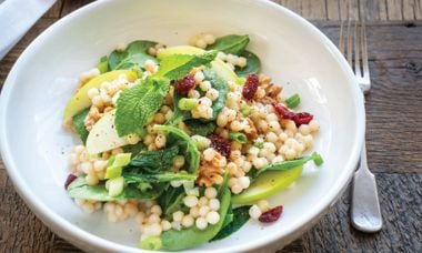 Warm Pearl Couscous Bowl with Spinach, Apple, Walnuts, and Tahini Dressing