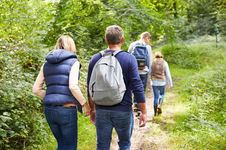 Family On Walk Through Beautiful Countryside