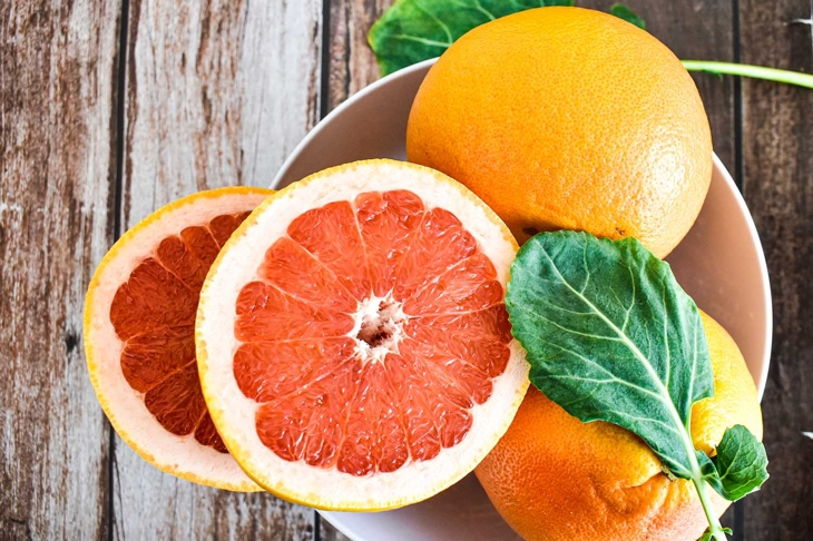 Grapefruits in bowl, juicy fruit