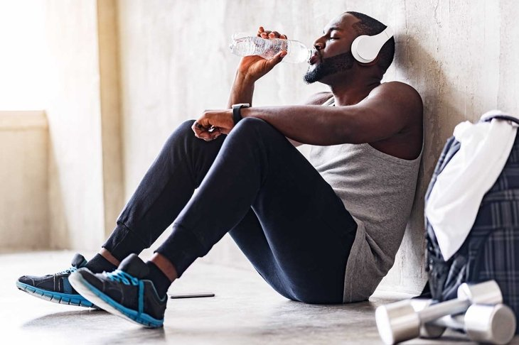 Exhausted handsome african sporty guy having leisure time