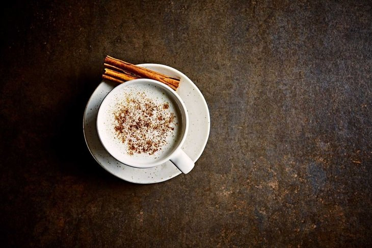 Moon milk with ashwagandha and cinnamon for better sleep. From top. Copy space