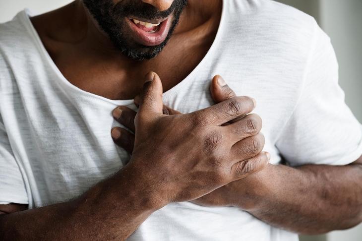 Black man having a heart attack