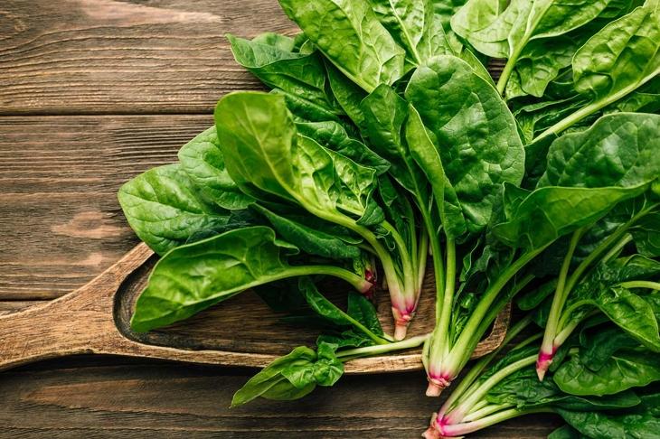 Fresh spinach on wooden background