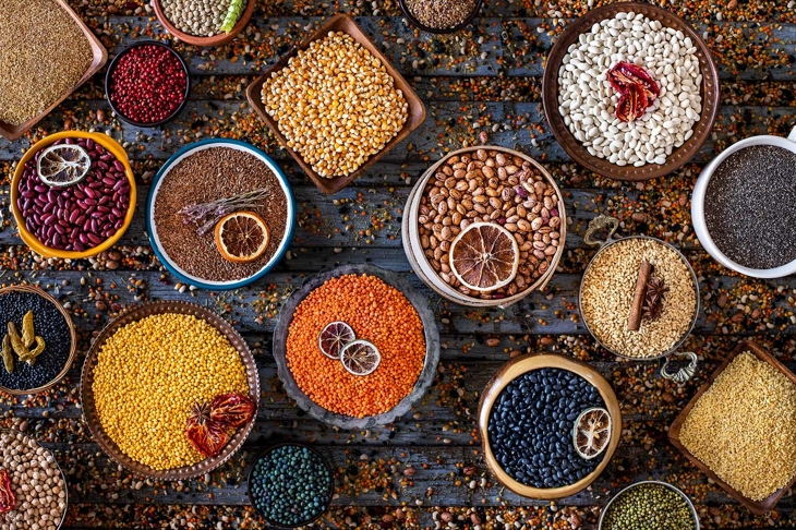 Many kinds of dried legumes on the table. Dried healthy foods concept.
