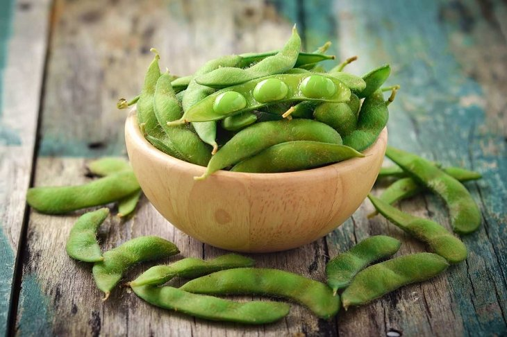 green soy beans in the wood bowl on table