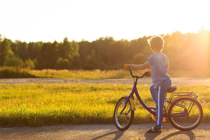 little boy riding bike at sunset, kids sport and  active lifestyle