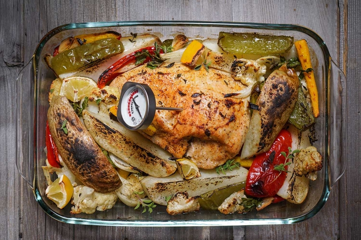 Roasted Turkey Breast with Mixed Vegetables/ Wood Background