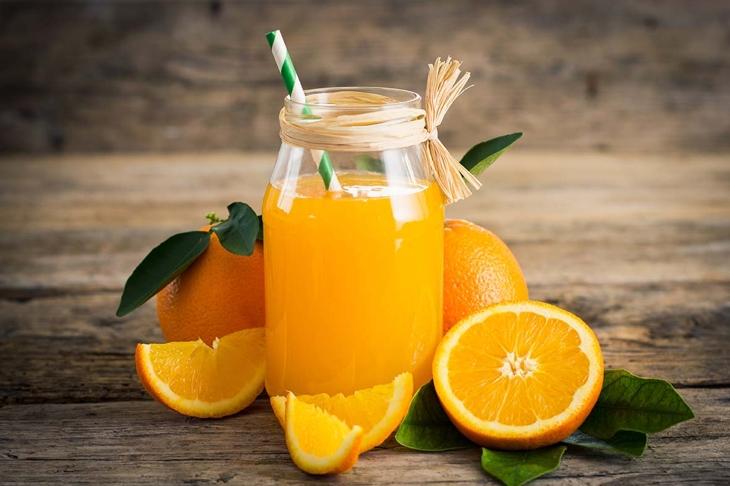 Fresh orange juice in the glass jar