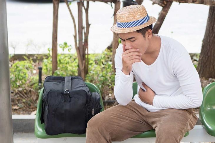 sick man traveler with nausea, stomachache, vomit, acid reflux