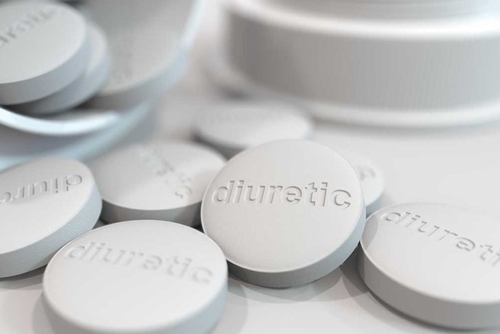 Close-up shot of pills with stamped DIURETIC text on them. 3D rendering