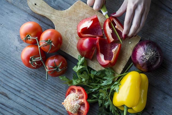 Woman's hand preparing salad