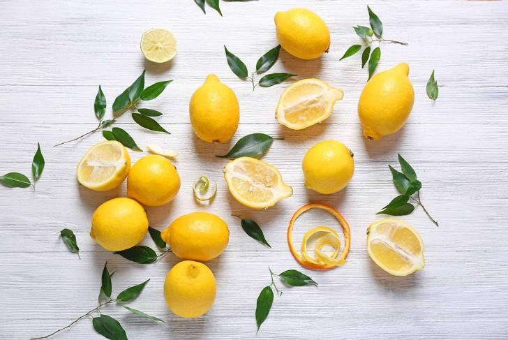Pile of lemons on wooden table